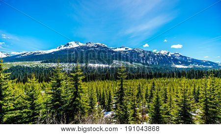 Snow capped mountain peaks of the Coast Mountain Range along the Duffey Lake Road, Highway 99, between Pemberton and Lillooet in southern British Columbia