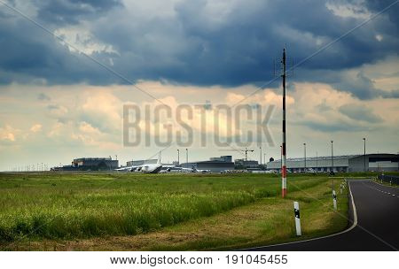 transport plane stands on the runway, in rainy, cloudy weather