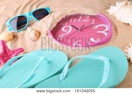 Pink Clock With Flip Flops, Sunglasses And Seashells In Beach Sand