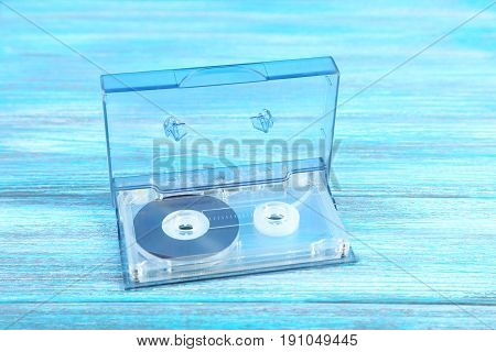 Cassette tape on the wooden table, close up