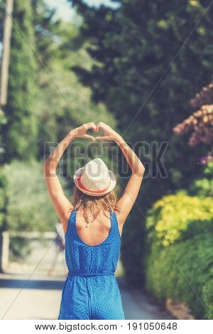 Girl making a heart shape symbol for love and respect.