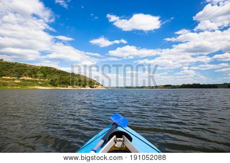 People enjou kayaking on beautiful river. Summer sunny time. Sport outdoor