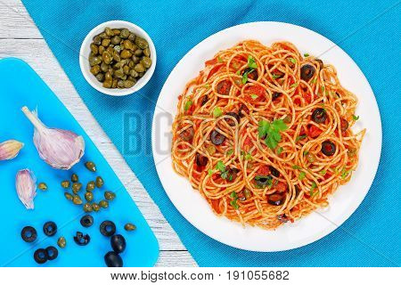 Pasta With Tomato Sauce, Capers And Olives