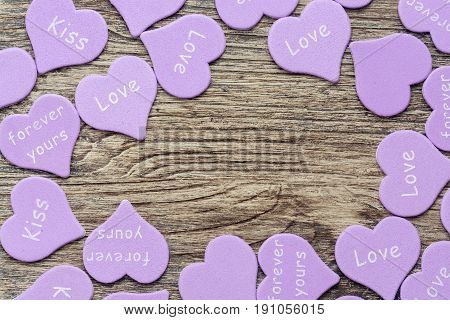 Lilac heart on a wooden surface. The wooden background with heart.