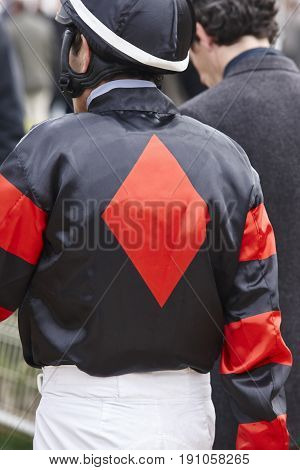 Jockey detail before the race. Hippodrome background. Racehorse. Competition