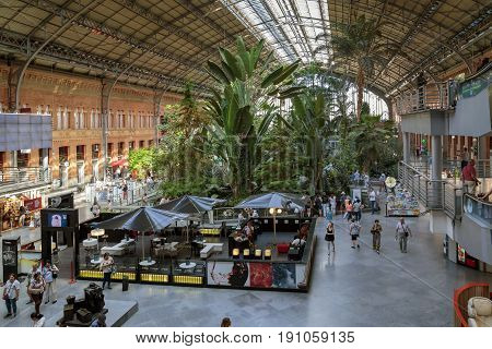 MADRID, SPAIN - MAY 24, 2017: This is a winter garden in the waiting hall of the railway station Atocha.