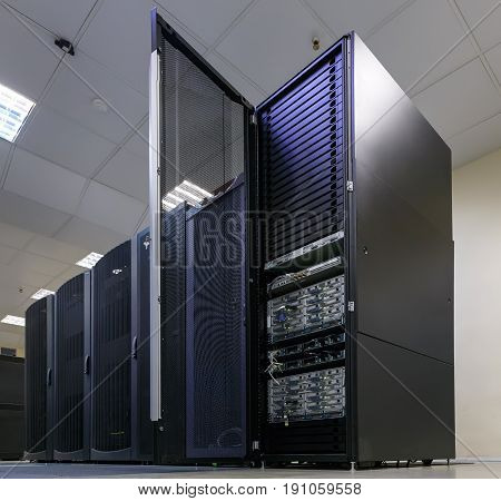 cluster disk storage with the door open in the data center.