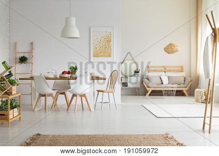 Simple bright dining room in slow life trend