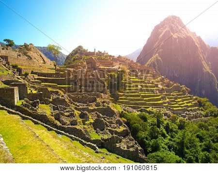 Ancient Inca City of Machu Picchu illuminated by sun. Ruins of Incan Lost city in Peruvian jungle. UNESCO World Heritage site, Peru, South America.