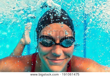 Female Swimmer Underwater. Underwater Image. Color Image