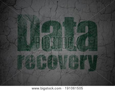Information concept: Green Data Recovery on grunge textured concrete wall background