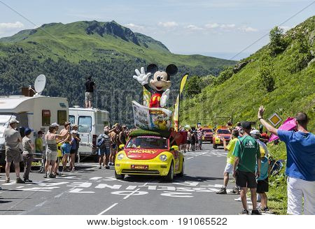 Pas de Peyrol France - July 62016: The Car of the Journal de Mickey during the passing of the Publicity Caravan on the road to Pas de Pyerol (Puy Mary) in Cantalin the Central Massif during the stage 5 of Tour de France on July 6 2016.