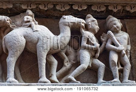 Sculptures on the external walls of Hindu temple in Khajuraho, India. Most Khajuraho temples were built between 950 and 1050 by the Chandela dynasty.