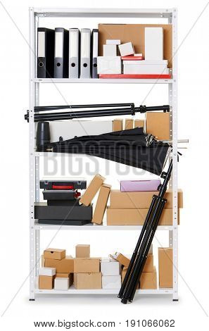 boxes and tools on shelves, white metal rack, isolated object photo, domestic and business warehouse concept