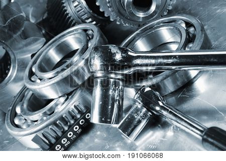 spanners with machine parts and tools, blue toning, gears and cogwheels