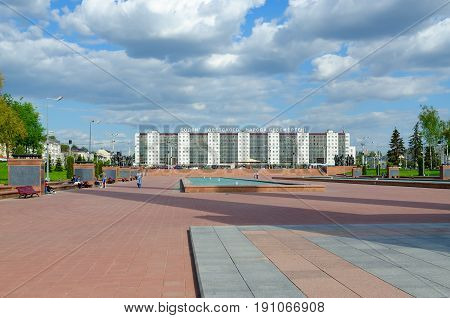 VITEBSK BELARUS - MAY 22 2017: Memorial complex in honor of Soviet soldiers-liberators partisans and underground workers of Vitebsk region on Victory Square. Unknown people rest on square