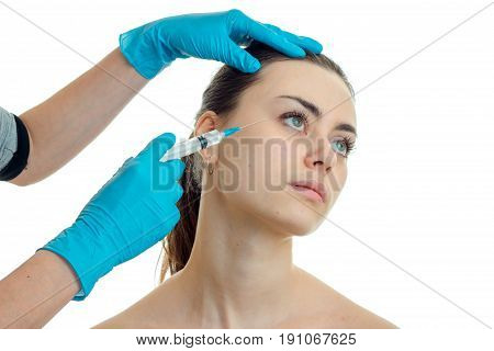 woman Rejuvenates the face off of a plastic surgeon and does prick isolated on white background