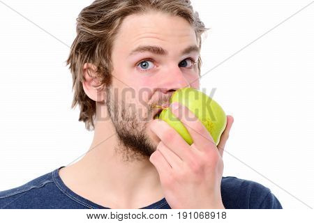 Young Man In Blue Tshirt Biting Big Green Apple