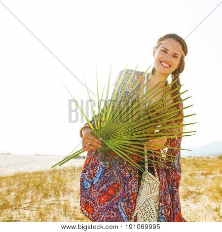 Happy Trendy Bohemian Chic Holding Big Green Tropical Leaf