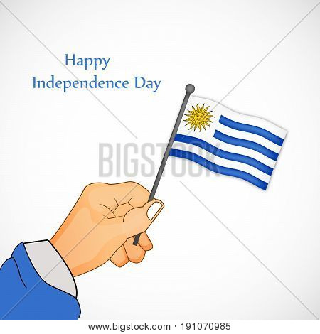 illustration of hand holding Uruguay Flag with Happy Independence Day Text
