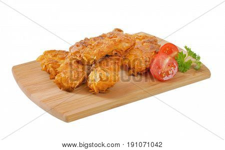 fried corn flake crusted chicken meat on wooden cutting board