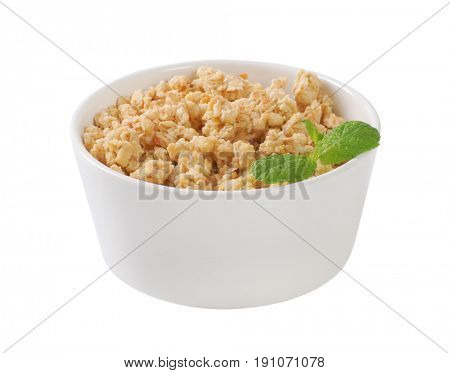 bowl of granola on off-white background