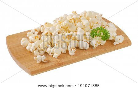 pile of fresh popcorn on wooden cutting board