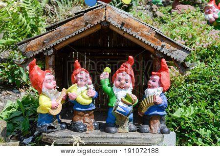 Garden Gnomes In A Garden Of A House At Engelberg