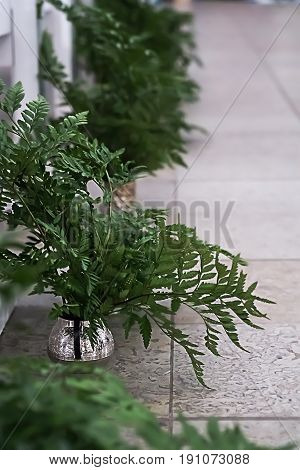 Green leaves of fern. Pieces of beautiful rustic wedding decoration.