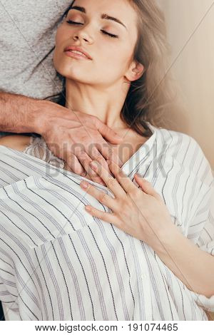 man touching chest of young sensual woman at home