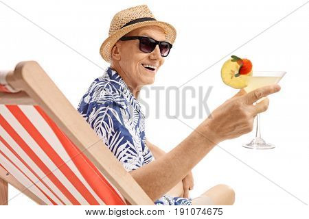 Elderly tourist with a cocktail sitting on a sun lounger isolated on white background