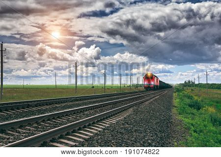 Freight train at railway station. Travel by train.