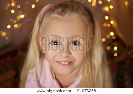 Portrait of cute funny girl in hovel, closeup