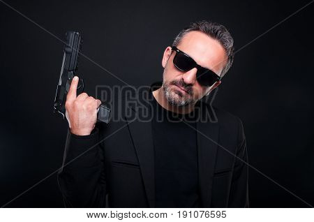 Killer Man With Pistol On Dark Background