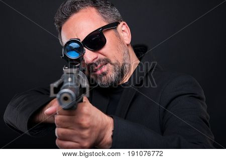 Mafia Murderer Aiming His Weapon