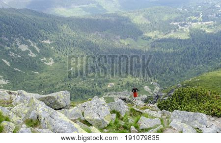 HIGH TATRAS, SLOVAKIA - JUNE 11: Tourists in the mountains go and look at the beautiful nature, on June 11, 2017 in High Tatras, Slovakia.