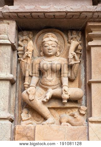 Durga Goddess - ancient bas-relief at famous erotic temple in Khajuraho, India. Most Khajuraho temples were built between 950 and 1050 by the Chandela dynasty