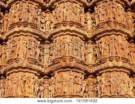 Ancient bas-relief at famous erotic temple in Khajuraho, India. Most Khajuraho temples were built between 950 and 1050 by the Chandela dynasty