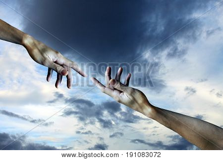 Men's hands on a sky background .