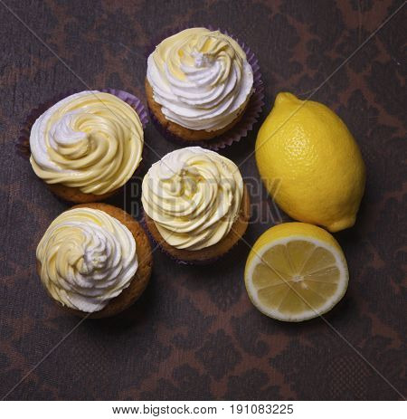 delicious freshly baked homemade lemon muffins cupcakes with butter cream onl copy space