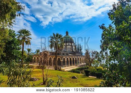 Israel, Sea of Galilee Beach. Dome and colonnade surrounded by a park. Catholic monastery and a small church Mount Beatitudes
