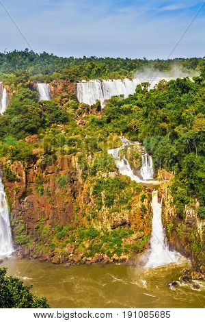 Several picturesque waterfalls. Iguazu Falls- grandiose complex of waterfalls on the border of Argentina, Brazil and Paraguay. The concept of extreme and exotic tourism