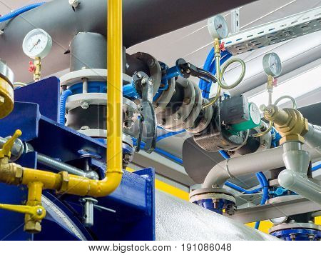 Manometer in pipe flow meter and faucet valves of heating system in a boiler room