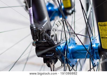 Bicycle hydraulic disk brakes on front wheel. Low depth photo