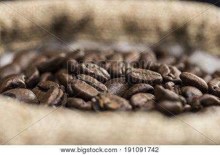 Coffee beans in burlap sack macro shot
