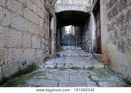 KORCULA, CROATIA - NOVEMBER 09: Narrow street in the old town of Korcula, Dalmatia, Croatia on November 09, 2016.