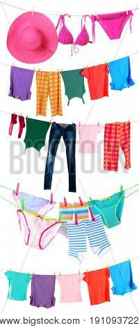 Different clothes hanging from clotheslines on white background