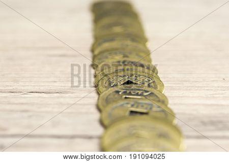 Close up shot of golden feng shui coins