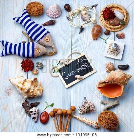 Summer Vacations Concept with Handmade Decorations Various Shells Dry Plants and Chalk Board with Inscription Summer closeup on Light Blue Wooden background