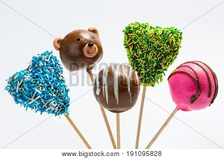 Colorful cake pops isolated on white background. delicious cace pops on white table.